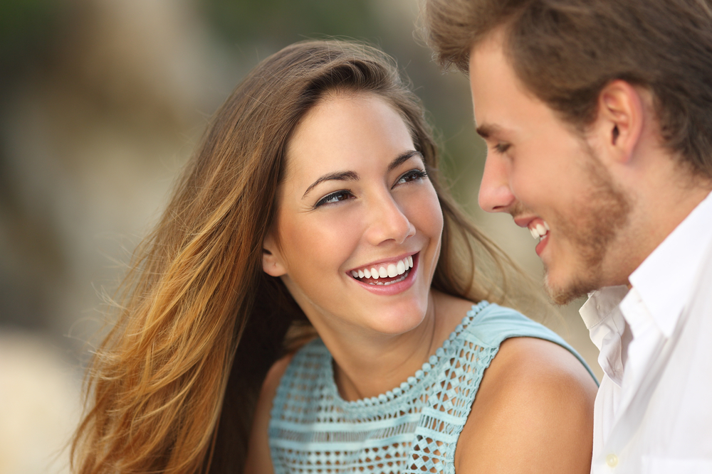West Kelowna Dentists - Smiling couple with perfect teeth