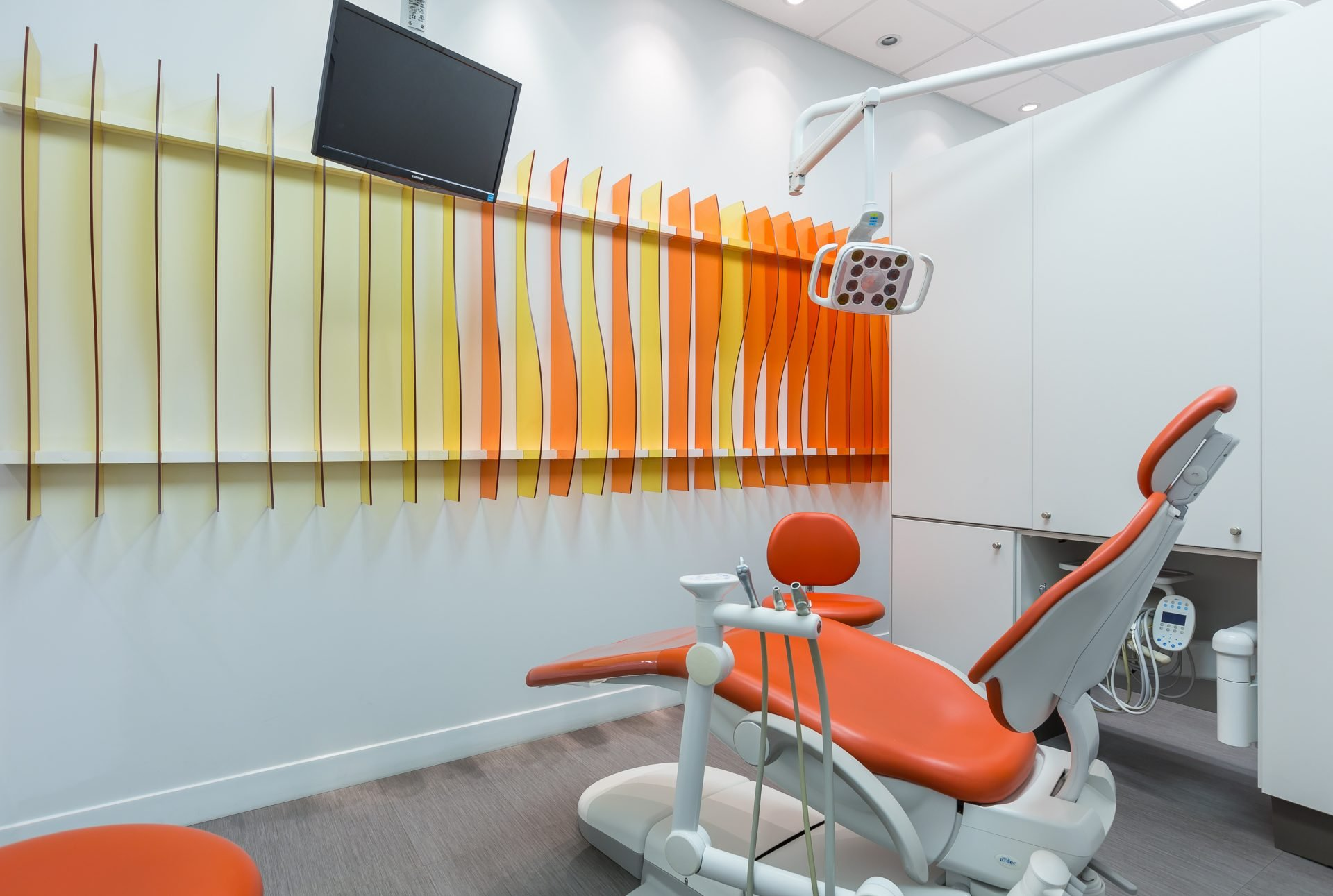 bright orange dental office and dark orange dental chair what is dental fluoride