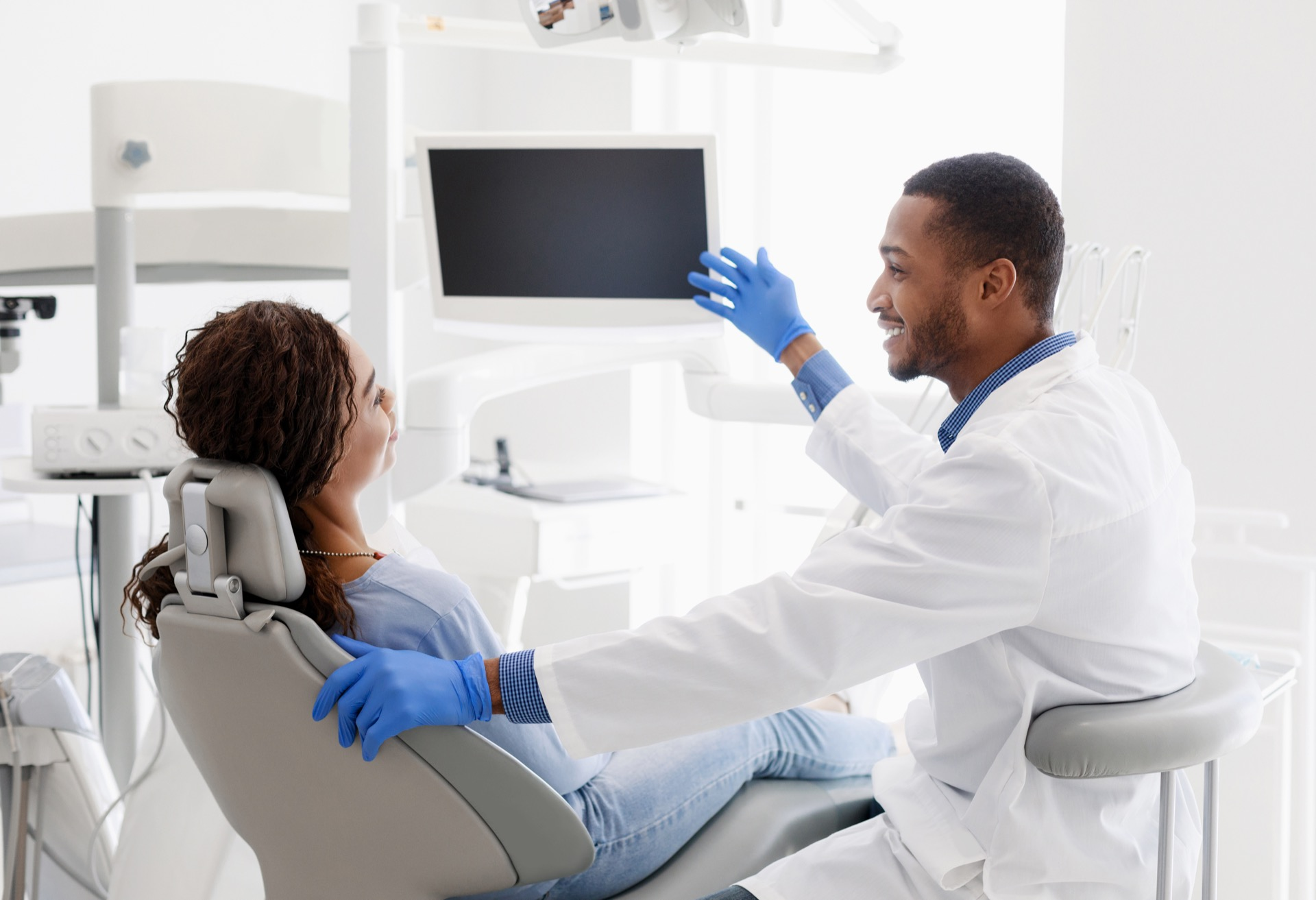 Dentist helping patient with dental anxiety