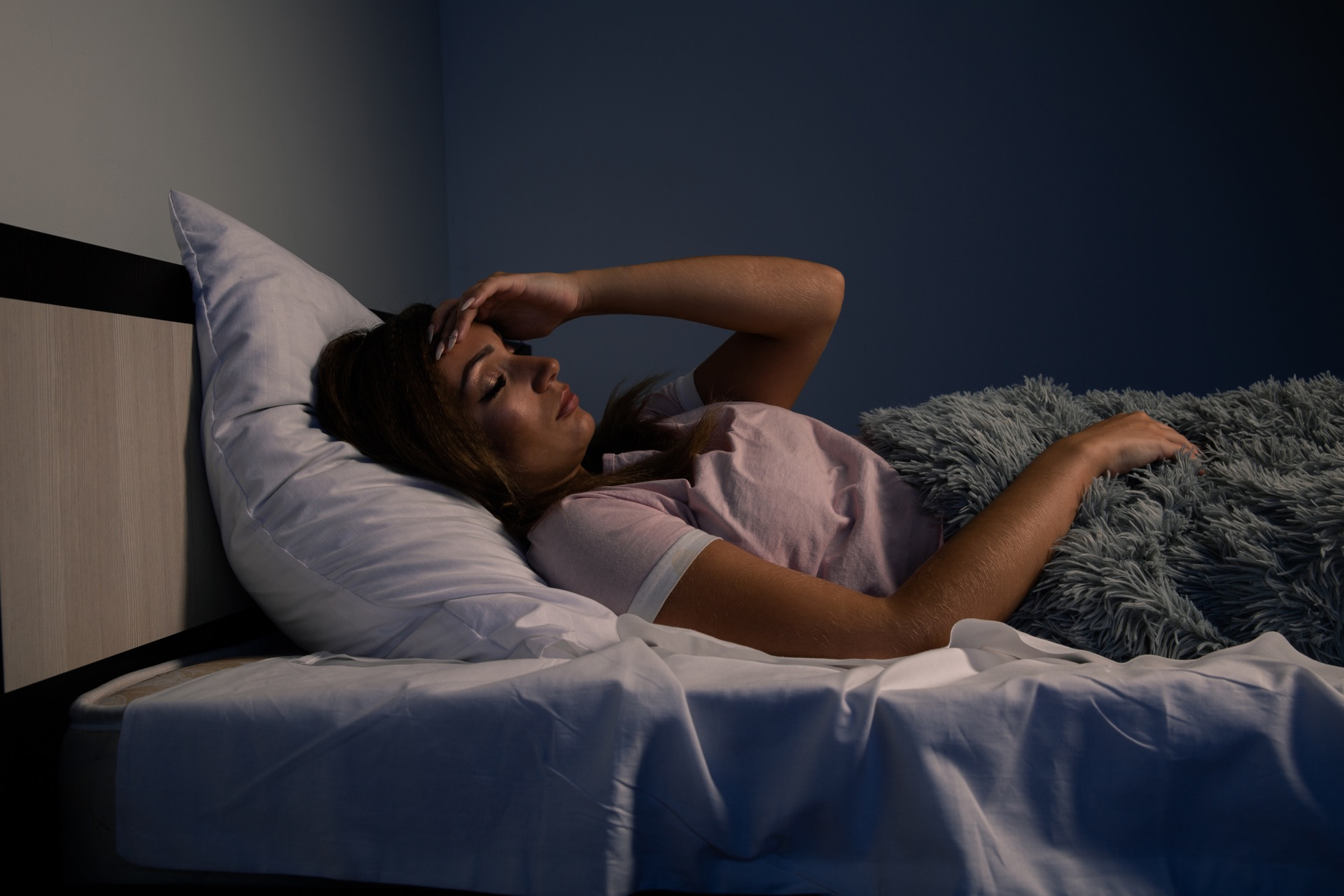Woman with night guard in bed