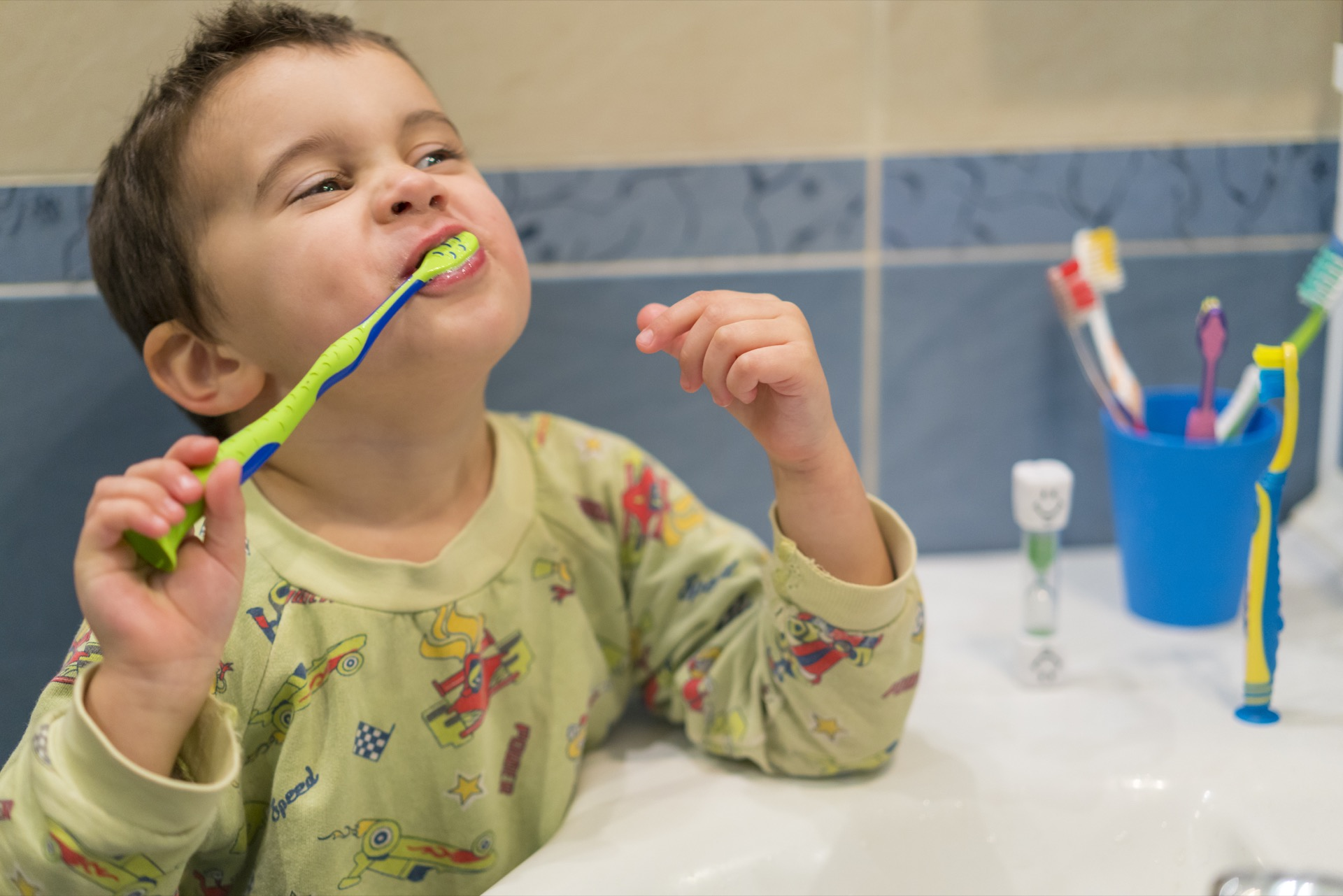 Toddler learning the proper tooth-brushing technique