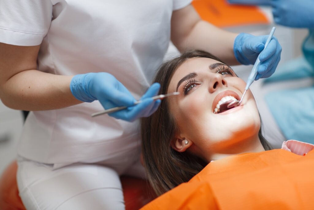 Dentist helping patient experiencing dental anxiety stay calm